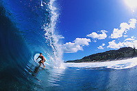 Surfer Luke Coelho in the tube at backdoor, on Oahu's famous north shore