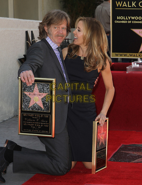 William H. Macy & Felictiy Huffman .Felictiy Huffman And William H. Macy Hollywood Walk Of Fame Induction Ceremony Held At On the Walk of Fame, Hollywood, California, USA.  .March 7th, 2012.full length moustache mustache facial hair married husband wife black suit dress suit kneeling profile .CAP/ADM/KB.©Kevan Brooks/AdMedia/Capital Pictures.