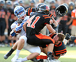 SIOUX FALLS, SD - SEPTEMBER 19: Jeremy Schick #21 from Rapid City Stevens is brought down by Jenson Amdahl #41, Caleb York #54, and Max Sturdevant #32 as his helmet flies off in the first quarter of their game Friday night at Howard Wood Field.  (Photo by Dave Eggen/Inertia)