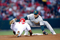 Marco Scutaro of the Oakland Athletics prepares to tag Howie Kendrick of the Los Angeles Angels during a game from the 2007 season at Angel Stadium in Anaheim, California. (Larry Goren/Four Seam Images)
