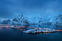 Winter twilight view over rorbu cabins of Sakrisøy, Reine, Moskenesøy, Lofoten Islands, Norway