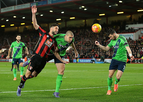 01.03.2016. Vitality Stadium, Bournemouth, England. Barclays Premier League. Bournemouth versus Southampton. Bournemouth Midfielder Andrew Surman is denied a header on goal by the challenge from Southampton Forward Shane Long