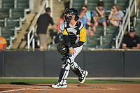 Rapidos de Kannapolis catcher Michael Hickman (37) makes a throw to second base against the Greensboro Grasshoppers at Kannapolis Intimidators Stadium on June 14, 2019 in Kannapolis, North Carolina. The Grasshoppers defeated the Rapidos de Kannapolis 4-1. (Brian Westerholt/Four Seam Images)
