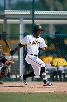 Pittsburgh Pirates Michael de la Cruz (27) follows through on a swing during an Instructional League intrasquad black and gold game on October 11, 2017 at Pirate City in Bradenton, Florida.  (Mike Janes/Four Seam Images)
