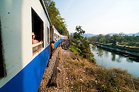Incredible view over the river Kwai whilst travelling along the death railway in Kanchanaburi, Thailand. The stunning landscape has made this a must do among tourists travelling to Thailand.