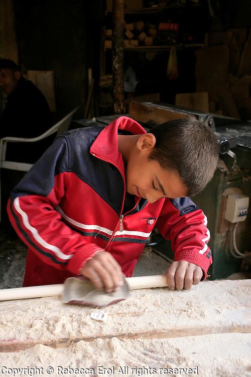 Young carpenter sanding wood in Adiyaman, Turkey