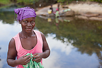 A woman in Robertsport, Liberia, washes clothes in a pond by the shore. While there is no shortage of fresh water in Liberia, clean, uncontaminated water is rare. Filtered water helps prevent disease from washing with water that contains parasites and other pathogens. The World Health Organization has estimated that poor sanitation and bad hygiene practices due to unsafe water cause about 18 per cent of all deaths in Liberia.