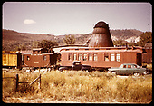 RGS refrigerator car #2101, caboose #0400 and outfit coach #0260. Sawdust burner in background.<br /> RGS  Ridgway, CO  ca. 1960-1965