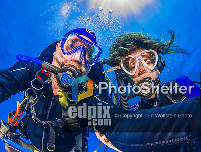 "22 July 2015: SCUBA Divers Sally Herschorn and Ed Wolfstein, pose for an underwater ""selfie"" image at Ocean Pointe Reef, on the North Shore of Grand Cayman Island. Located in the British West Indies in the Caribbean, the Cayman Islands are renowned for excellent scuba diving, snorkeling, beaches and banking.  Mandatory Credit: Ed Wolfstein Photo *** RAW (NEF) Image File Available ***"