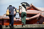 A young family makes their way through the grounds of Shuri-jo Castle in Naha, Okinawa Prefecture, Japan, on June 24, 2012. Photographer: Robert Gilhooly