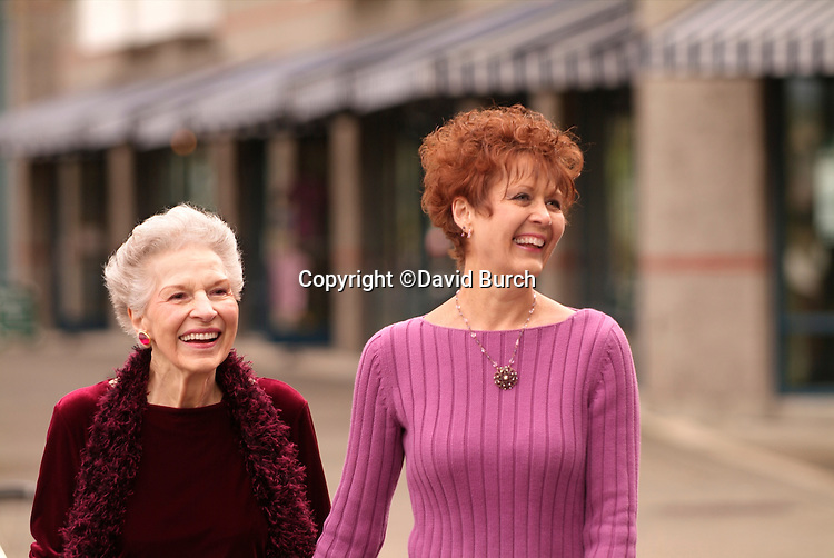 Redhead woman and her mother walking outdoors