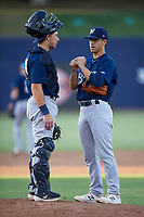 AZL Brewers Blue catcher Alex Hall (33) talks to relief pitcher Ian Exposito (25) during an Arizona League game against the AZL Brewers Gold on July 13, 2019 at American Family Fields of Phoenix in Phoenix, Arizona. The AZL Brewers Blue defeated the AZL Brewers Gold 6-0. (Zachary Lucy/Four Seam Images)