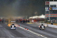 Aug. 3, 2013; Kent, WA, USA: NHRA top fuel dragster driver Antron Brown (left) races alongside Khalid Albalooshi during qualifying for the Northwest Nationals at Pacific Raceways. Mandatory Credit: Mark J. Rebilas-USA TODAY Sports