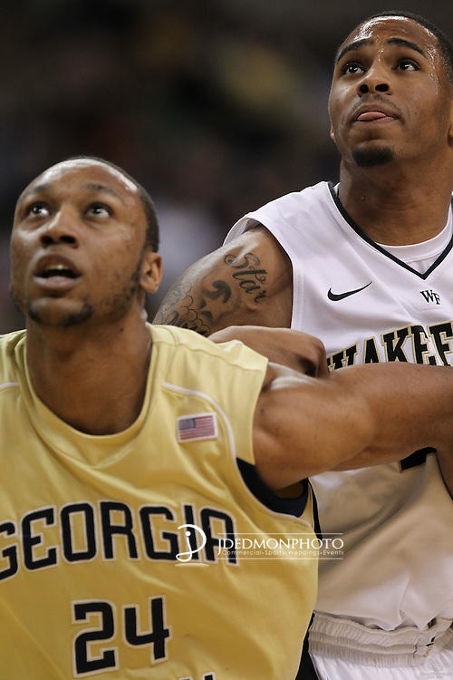 Wake Forest Demon Deacons forward Ari Stewart (20) and Georgia Tech Yellow Jackets forward Kammeon Holsey (24) eye the rebound. Georgia Tech leads at the half 35-28.
