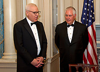 David M. Rubenstein, Chairman, John F. Kennedy Center for the Performing Arts, left, and United States Secretary of State Rex Tillerson, right, in discussion prior to the five recipients of the 40th Annual Kennedy Center Honors posing for a group photo following a dinner hosted by Secretary Tillerson in their honor at the US Department of State in Washington, D.C. on Saturday, December 2, 2017. Photo Credit: Ron Sachs/CNP/AdMedia