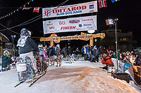 Nick Petit at the finish line in Nome, Alaska early on Wednesday morning March 14th as places 2nd in the 46th running of the 2018 Iditarod Sled Dog Race.  <br /> <br /> Photo by Jeff Schultz/SchultzPhoto.com  (C) 2018  ALL RIGHTS RESERVED