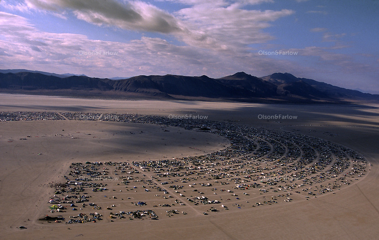 A road system is laid out in a semi-circle of campers gather for the annual, weeklong Burning Man Festival held at Black Rock Desert in northwestern Nevada's Conservation area.  Tens of thousands of revelers gather for a week of counter-culture celebration of art and experience.