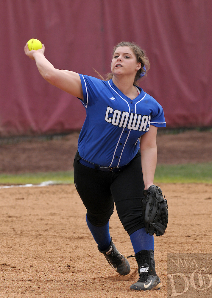 NWA Democrat-Gazette/BEN GOFF -- 03/21/15 Kaylee St John of Conway throws to first during the game against Farmington in the Farmington/Fayetteville Classic softball tournament at Farmington High School on Saturday, Mar. 21, 2015.