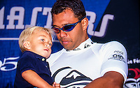 Sunny Garcia (HAW) on the podium with his son Stone Garcia (HAW) after winning the 1995 Quiksilver Surf Masters at the Grand Plage, Biarritz in the South West of France. Photo: joliphotos.com