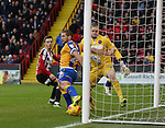 Stefan Scougall of Sheffield Utd looks on as the ball is cleared off the line during the English League One match at the Bramall Lane Stadium, Sheffield. Picture date: November 19th, 2016. Pic Simon Bellis/Sportimage