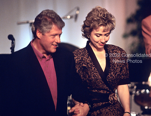 """United States President Bill Clinton and first lady Hillary Rodham Clinton hold hands as they leave the stage following their making remarks  during the taping of the PBS series """"In Performance at the White House"""" on the South Lawn of the White House in Washington, D.C. on June 18, 1993. The show is to honor the 40th anniversary of the Newport Jazz Festival.  <br /> Credit: Ron Sachs / CNP"""