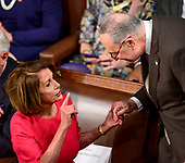 Speaker of the United States House of Representatives Nancy Pelosi (Democrat of California) and United States Senate Minority Leader Chuck Schumer (Democrat of New York) converse as the 116th Congress convenes for its opening session in the US House Chamber of the US Capitol in Washington, DC on Thursday, January 3, 2019.<br /> Credit: Ron Sachs / CNP<br /> (RESTRICTION: NO New York or New Jersey Newspapers or newspapers within a 75 mile radius of New York City)