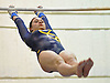 Gillian Murphy of Massapequa performs on the uneven bars during a Nassau County varsity gymnastics meet against host Long Beach High School in Lido Beach on Thursday, Jan. 11, 2018. She scored an 8.30 in the event and won the all-around with a 35.30. Massapequa won the meet by a score of 166.30-152.20.