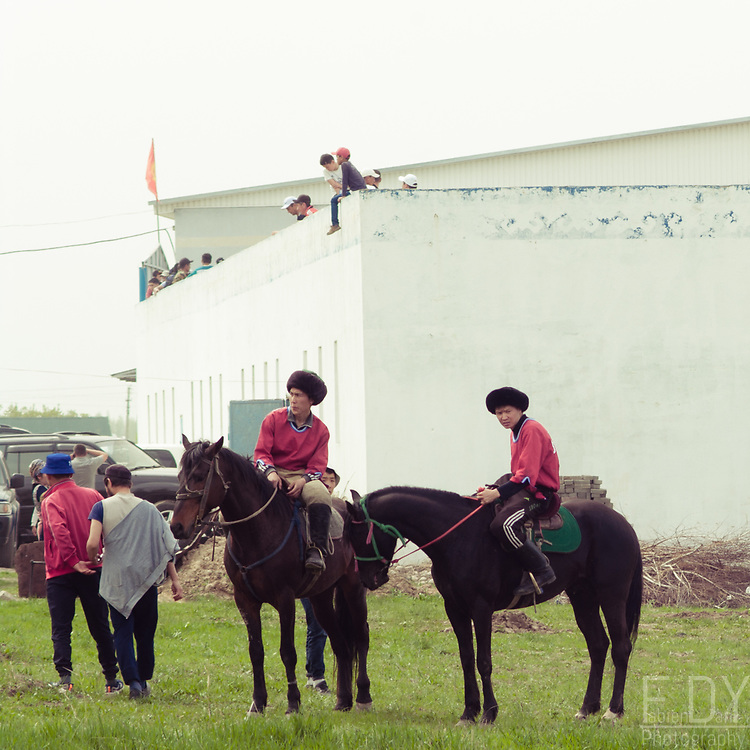 Players of Kok Boru relaxing before their game. Kok Boru is a popular horse sport in Kyrgyzstan and other Central Asian countries. This game takes place between two teams of 6 to 10 riders whose object is to throw a goat carcass into the opposing team's goal.