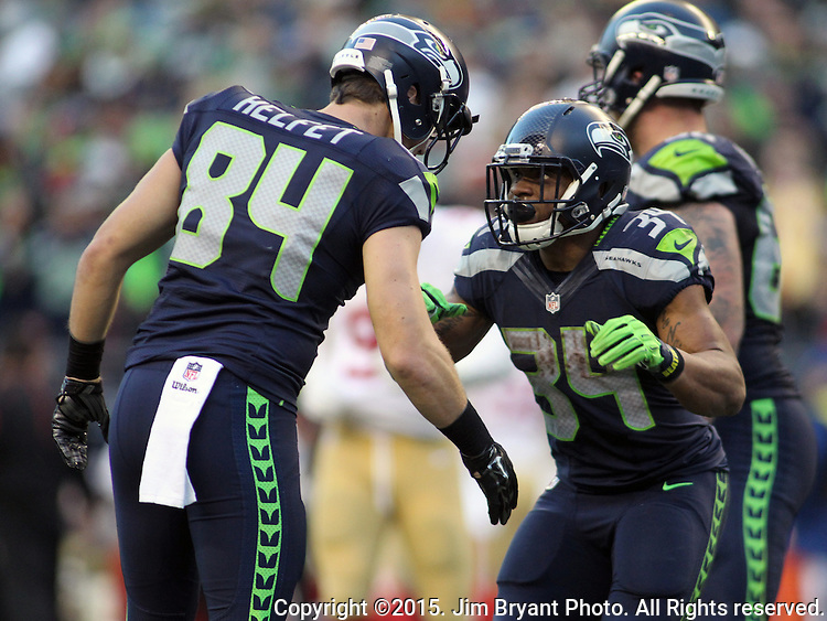 Seattle Seahawks running back Thomas Rawls (34) celebrates with tight end Cooper Helfet (84) after running for a 31-yard touchdown San Francisco 49ers at CenturyLink Field in Seattle, Washington on November 22, 2015.  The Seahawks beat the 49ers 29-13.   ©2015. Jim Bryant Photo. All RIghts Reserved.