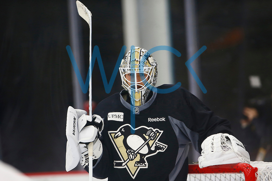 Matt Murray #30 of the Pittsburgh Penguins stands in goal during practice at UPMC Lemieux Sports Complex in Cranberry Township, Pennsylvania on June 8, 2016. (Photo by Jared Wickerham / DKPS)