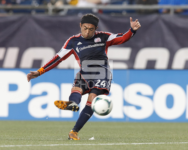 New England Revolution midfielder Lee Nguyen (24) takes a direct kick. In a Major League Soccer (MLS) match, Real Salt Lake (white)defeated the New England Revolution (blue), 2-1, at Gillette Stadium on May 8, 2013.