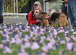 Army veteran Sarah Goulet and her service dog Chaos participate in the Western Nevada College 2nd annual Suicide Awareness March in Carson City, Nev. on Saturday, May 7, 2016. The event raises awareness about the average 22 veteran suicides each day in the U.S. and the local services available to help. <br />