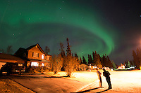 Shelly and Ken Peterson watch as the aurora borealis, or northern lights, fills the sky in the early hours above their Kenai, Alaska, neighborhood.