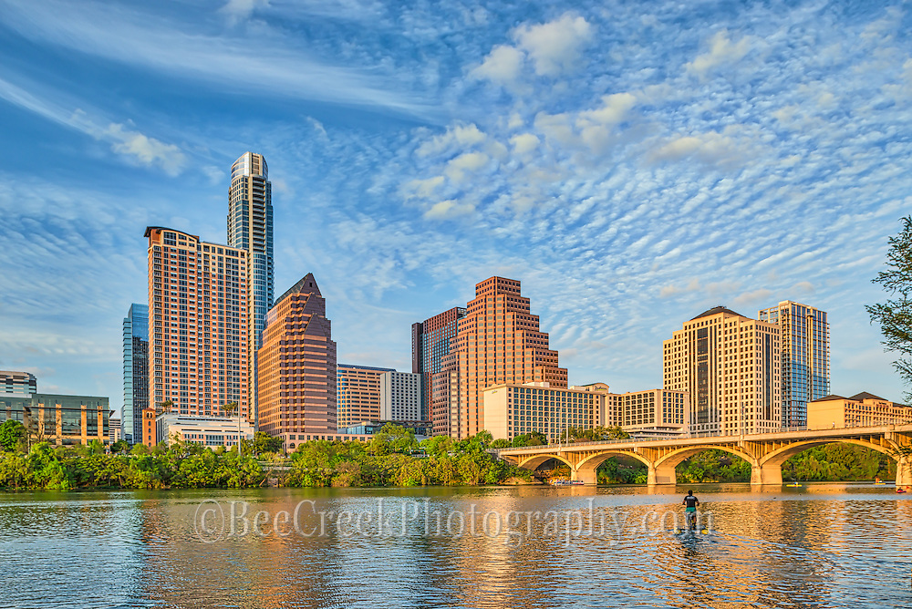 We captured this along the hike and bike trail and really liked the clouds behind the Austin skyline with the beautiful blue sky and you can see a lone water bike pedding his way on Ladybird Lake towards the Congress bridge on his way out to watch the bats fly from under the Ann Richard Congress Bridge.