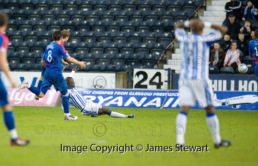 CALEY'S ANDREW SHINNIE SCORES INVERNESS' THIRD GOAL.