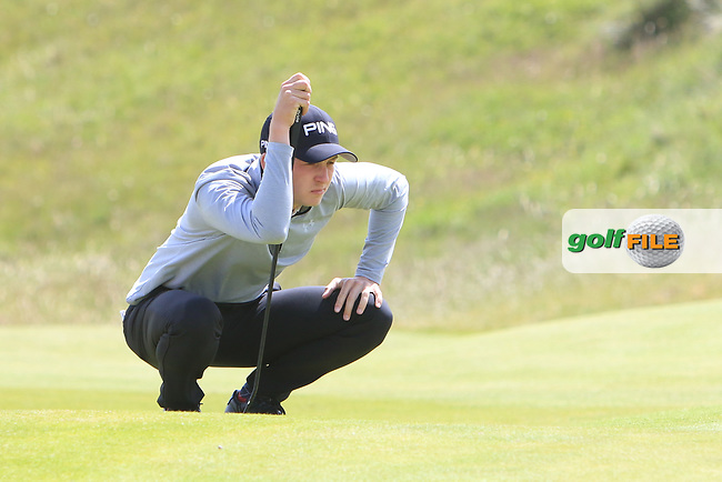 Charlie Thornton (Fulford) on the 4th green during Round 1 of the The Amateur Championship 2019 at The Island Golf Club, Co. Dublin on Monday 17th June 2019.<br /> Picture:  Thos Caffrey / Golffile<br /> <br /> All photo usage must carry mandatory copyright credit (© Golffile | Thos Caffrey)