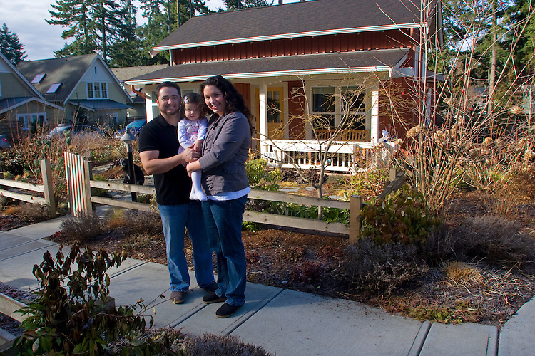 Redmond, Washington, State, Cottage Company, Danielson Grove, new, green built, cottage house development, Elisabeth and Russ Oja with daughter in front of their cottage,
