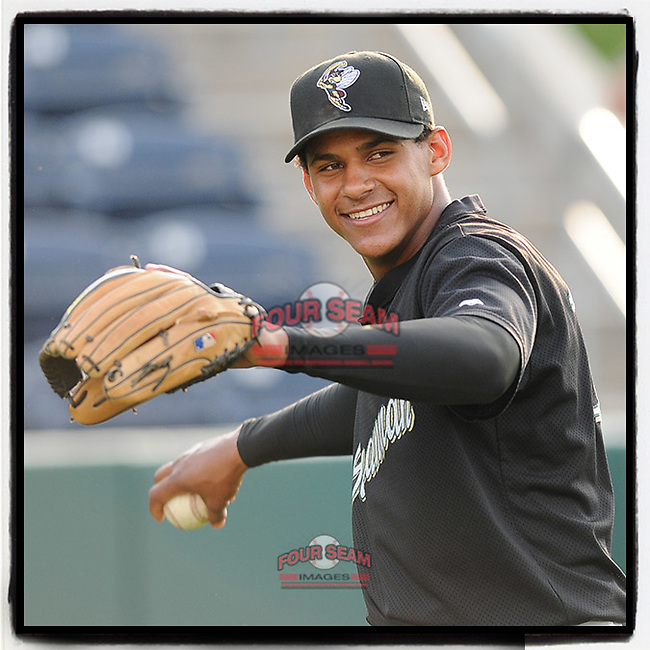 #OTD On This Day, April 30, 2009, Jefry Marte of the Savannah Sand Gnats warmed up before a game at Fluor Field at the West End in Greenville, S.C. Marte went on to play for the Tigers and Angels. He now plays for the Hanshin Tigers in Japan. (Tom Priddy/Four Seam Images) #MiLB #OnThisDay #MissingBaseball #nobaseball #stayathome #minorleagues #minorleaguebaseball #Baseball #SallyLeague #AloneTogether