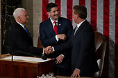 United States Vice President Mike Pence, left, Speaker of the House of Representatives Paul Ryan, Republican of Wisconsin, center, and Senator Jeff Flake, Republican of Arizona, right, speak in the House Chamber prior to French President Emmanuel Macron delivering a joint address to the United States congress at the United States Capitol in Washington, DC on April 25, 2018. Credit: Alex Edelman / CNP