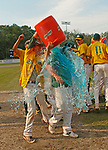 Middletown, CT-061017MK20 Holy Cross' Michael Cipriano  dumps the team's water bucket over coach Mike Phelan after winning the Class S state final at Palmer Field in Middletown on Saturday afternoon. The Crusaders defeated Lyman Memorial 13-9. Michael Kabelka / Republican-American
