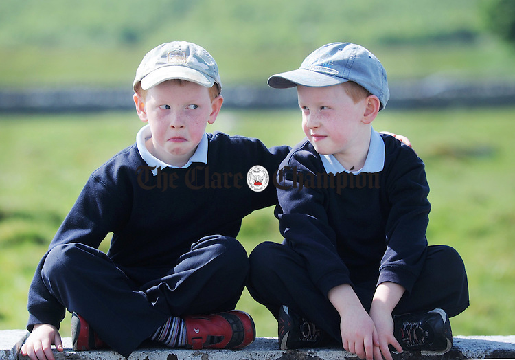 Peter Collins and his brother Patrick looking suspicious during breaktime at Kilfenora National School. Photograph by Declan Monaghan
