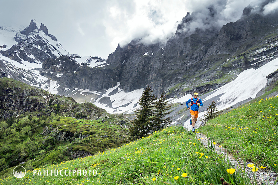 Trail running in moody, cloudy weather on a spring day above Lauterbrunnen, Switzerland