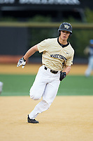 Stuart Fairchild (4) of the Wake Forest Demon Deacons hustles towards third base against the Georgia Tech Yellow Jackets at David F. Couch Ballpark on March 26, 2017 in  Winston-Salem, North Carolina.  The Demon Deacons defeated the Yellow Jackets 8-4.  (Brian Westerholt/Four Seam Images)