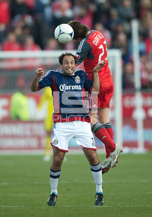 14 April 2012: Chivas USA midfielder Nick LaBrocca #10 and Toronto FC midfielder Terry Dunfield #23 in action during the second half in a game between Chivas USA and Toronto FC at BMO Field in Toronto..Chivas USA won 1-0.