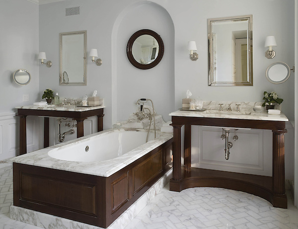 This custom bathroom features a handmade Puccini mosaic floor shown in Calacatta Tia.<br />