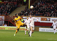 Joe Shaughnessy heads before being challenged by Zaine Francis-Angol in the Motherwell v Aberdeen, Clydesdale Bank Scottish Premier League match at Fir Park, Motherwell on 26.12.12.