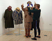 BNPS.co.uk (01202 558833)<br /> Pic: BNPS<br /> <br /> Pictured: Some of John McCririck's flamboyant suits up for auction<br /> <br /> The widow of the late racing pundit John McCririck is selling off his wardrobe of clothes and jewellery.<br /> <br /> The TV personality was known for wearing deerstalker hats, flamboyant suits and oversized gold rings as he delivered the betting news at the races on Channel 4 for years.<br /> <br /> He did July aged 79 and now his widow Jenny has decided to put some of his possessions up for sale.<br /> <br /> She said part of the reason was that she was worried thieves would target her because of the jewellery that her husband was famous for wearing.