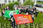 Fybough NS, Castlemaine has received the Green Flag and Jep flag. Pictured  Holding the Junior Entrepreneur Flag were Erin Evans, Roisin Evans, Shane Evans and Tadgh Evans. Holding the Green Flag were Ava Ladden, Jade Kelleher, Paul Costello and Finan Griffin with students and staff members on Tuesday
