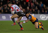 Gloucester's Louis Rees-Zammit is tackled by Montpellier's Kahn Fotuali'i<br /> <br /> Photographer Bob Bradford/CameraSport<br /> <br /> European Rugby Heineken Champions Cup Group E - Gloucester v Montpellier Herault Rugby - Saturday 11th January 2020 - Kingsholm Stadium - Gloucester<br /> <br /> World Copyright © 2019 CameraSport. All rights reserved. 43 Linden Ave. Countesthorpe. Leicester. England. LE8 5PG - Tel: +44 (0) 116 277 4147 - admin@camerasport.com - www.camerasport.com