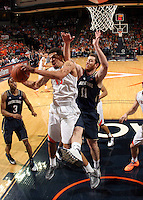 Virginia forward Anthony Gill (13) grabs the rebound next to Notre Dame center Garrick Sherman (11) during the game Saturday, February 22, 2014,  in Charlottesville, VA. Virginia won 70-49.
